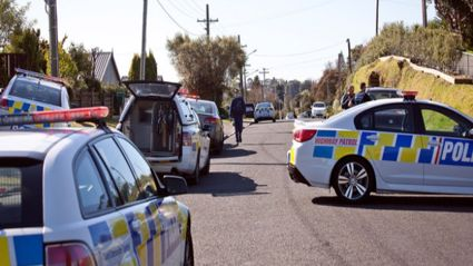 Police respond to reports of a stabbing on Mansels Road. Photo/Andrew Warner.