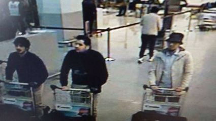 Police issued a wanted notice for the man in white, seen here in the check-in area with two other suspects minutes before the blasts.