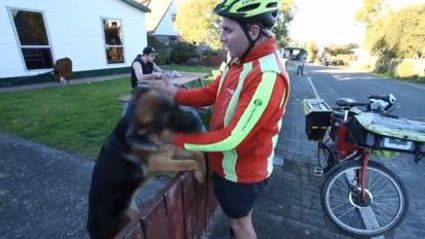 Video: The World Has Fallen in Love with the Bond Between Kiwi Postie and Dog