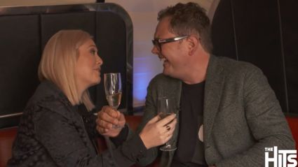 Watch: Alan Carr Joins Sarah Gandy on The Hits 90s Bus