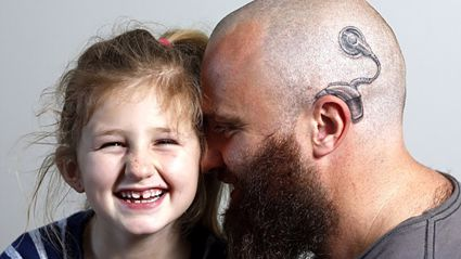Amazing dad gets tattoo to match his daughter's hearing aid