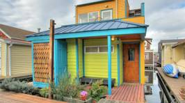 This colourful tiny boathouse will take your breath away