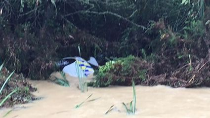 A police car was washed off a road in a flash flood near Kawakawa Bay. Photo/Angela Heenan