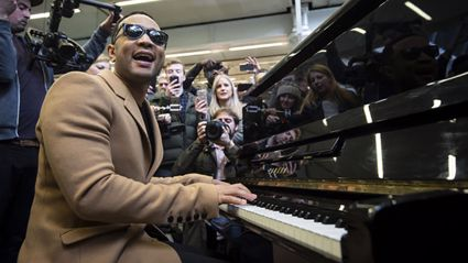 John Legend surprises commuters with epic impromptu performance at a London train station