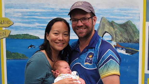 Grateful parents Naomi Facey and Neil Bolton with baby Emilia, who turns three weeks old tomorrow. Photo / Peter de Graaf