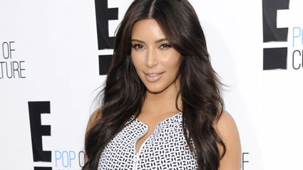 Kim Kardashian flaunts weight loss in silver bikini