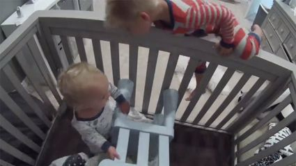 Toddler caught on camera helping baby brother out of his crib