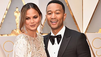 Chrissy Teigen accidentally flashes audience while dancing on stage with John Legend
