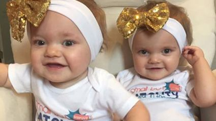 Kendal is an identical twin and both she and her sister Kenedi (pictured together) were diagnosed with cancer after their mother Abby Breyfolgle noticed sores on their bodies. Photo / Facebook
