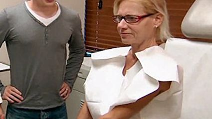 Woman gets her 13kg breast implants removed after they could have killed her