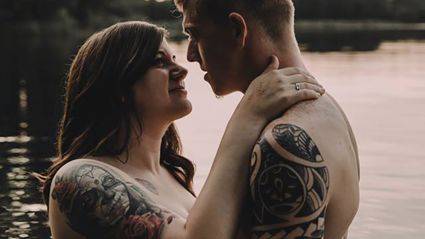 Woman fired over topless engagement photos with fiance