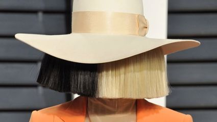 Sia reveals her face and flashes her breast in new Instagram picture