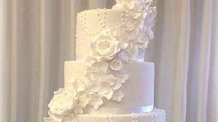 This couple's wedding cake may look normal, but it's hiding a very cool secret!