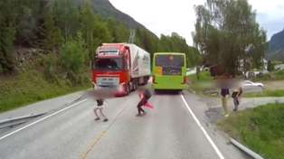 Viral video shows shocking moment truck narrowly avoids hitting child in road