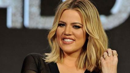 Khloe Kardashian shows off growing bump in stunning silver jumpsuit