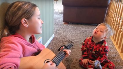 Heart-warming moment big sister teaches brother with Down syndrome to sing