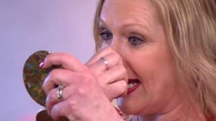 Shocking moment woman removes prosthetic nose on live TV