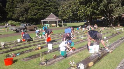 Kamo Scouts clean RSA graves at Maunu Cemetery ahead of Anzac Day