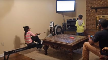 Genius dad builds rowing machine to power his kids' video games so they still exercise