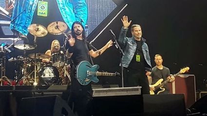 WATCH: John Travolta joins the Foo Fighters on stage for epic 'Grease' rendition