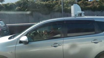 Shocking photo shows Auckland mum driving with a baby on her lap