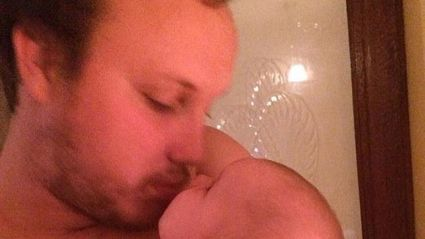 A new father has been called 'paedophile' over this photo ...