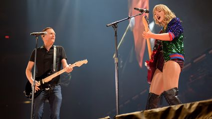 Bryan Adams joins Taylor Swift on stage for surprise duet of 'Summer of '69' - and it is AMAZING!