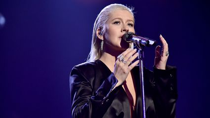 Christina Aguilera's four-year-old daughter joins her on stage for 'Beautiful' singalong