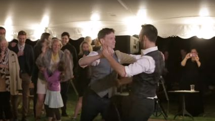 Grooms surprise their wedding guests with an EPIC 'Dirty Dancing' inspired first dance!