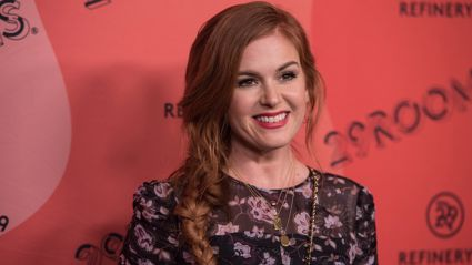 Isla Fisher is unrecognisable after dying her iconic red hair peroxide blonde!