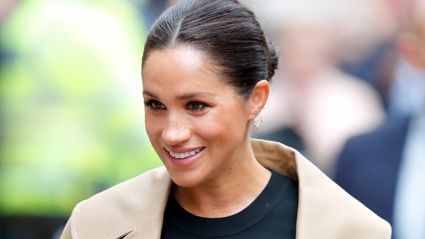 Meghan Markle shows off six-month baby bump in tight-fitting black dress