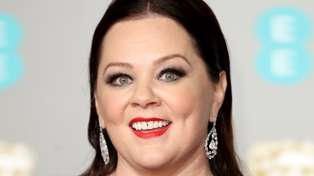 Melissa McCarthy proudly shows off 35kg weight loss in figure-hugging black dress at the BAFTAs