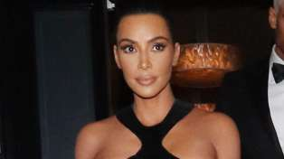 Kim Kardashian steps out  in shocking dress with breasts almost entirely on display