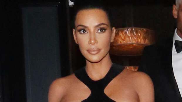 1193dc3fa2d8 Kim Kardashian steps out in shocking dress with breasts almost entirely on  display