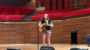 Olivia is the first person to perform at the Town Hall!