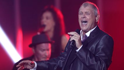 Australian rockstar John Farnham has been rushed to hospital
