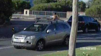 Shocking footage shows Perth mum driving with son strapped to roof rack