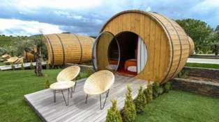 You can now sleep in giant five-star wine barrels!
