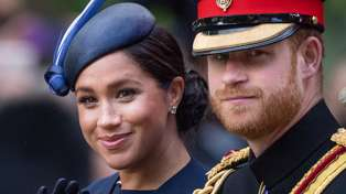 Prince Harry caught on camera 'telling off' Meghan Markle at Trooping the Colour