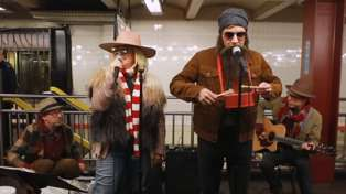 Watch Alanis Morissette and Jimmy Fallon sing Christmas carol in New York subway in disguise