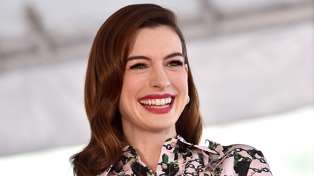 Anne Hathaway has reportedly given birth after being snapped with newborn carrier