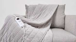Kmart and The Warehouse now sell 'heated throws' and they're a must have for winter